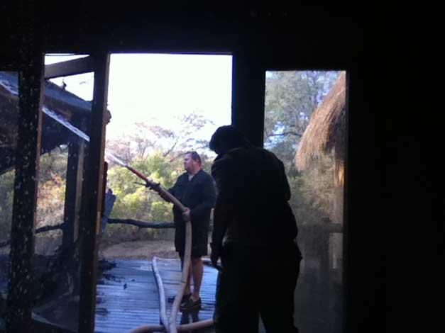 Carl wielding the hose